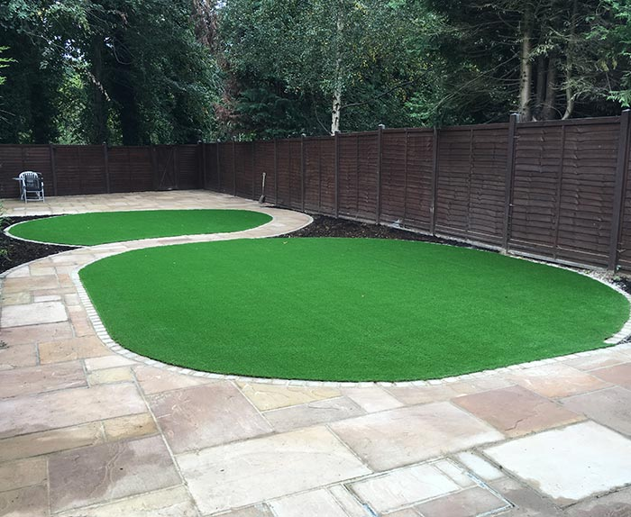 Artificial Grass and Sandstone Patio With Edgings in Welwyn Garden City