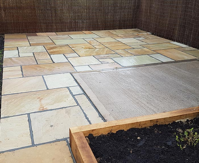 Mint Fossil Sandstone Paving and Oak Sleeper Flower Bed in Welwyn